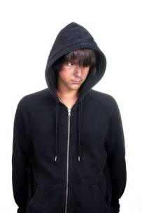 10411778-closeup-of-a-teenager-wearing-a-hoodie-underlit-on-white-background