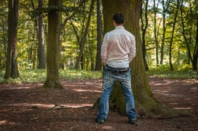 depositphotos_120671248-stock-photo-standing-man-peeing-near-big