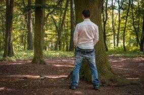 depositphotos_120671248-stock-photo-standing-man-peeing-near-big